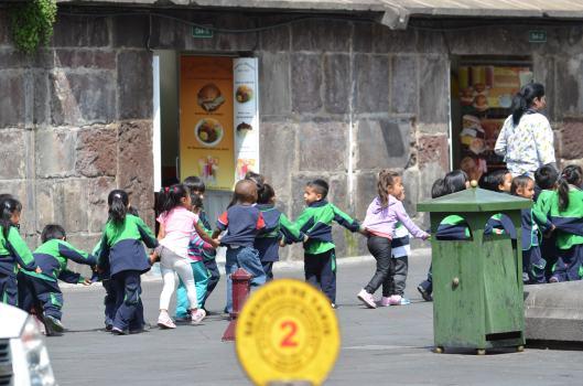 School children navigate Old Town Quito