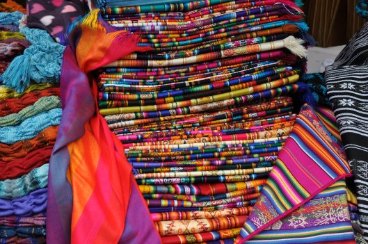 What the Otavalo people are known for: their beautiful, bright woven woolen fabric.