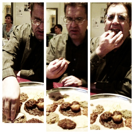 Steve demonstrates with great effectiveness on how to eat Ethiopian food.